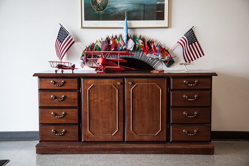 Delta Qualiflight cabinet with toy planes and mini flags
