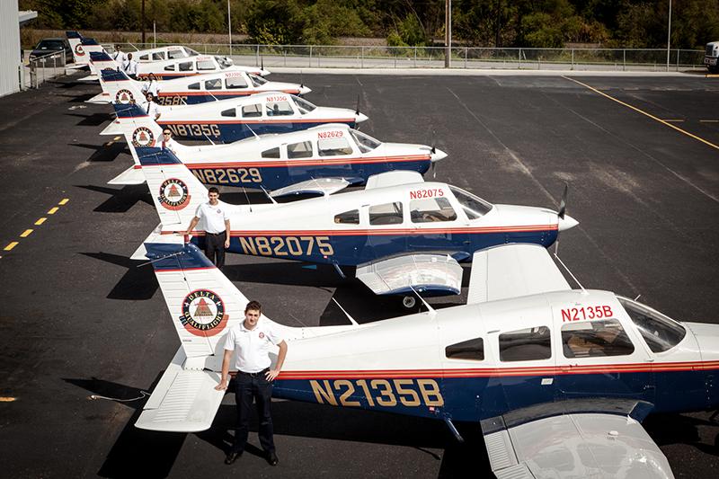 Delta Qualiflight Aviation posing beside Delta Qualiflight Aviation's planes